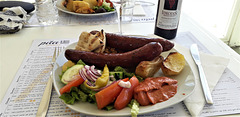 Greek meal of countryside sausages for lunch.