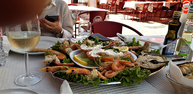 Sea food for two - lunch at outdoor table.