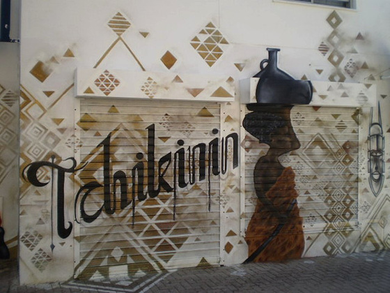 Painted on wall and blinds of Tchikinin Café.