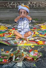 Mayun praying at Kuningan