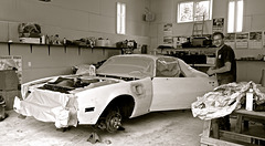Floyd working on the car.