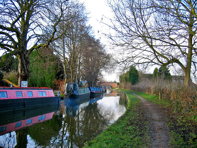 Looking back towards Swan Bridge No.80 (Grade II Listed Building) on the Coventry Canal