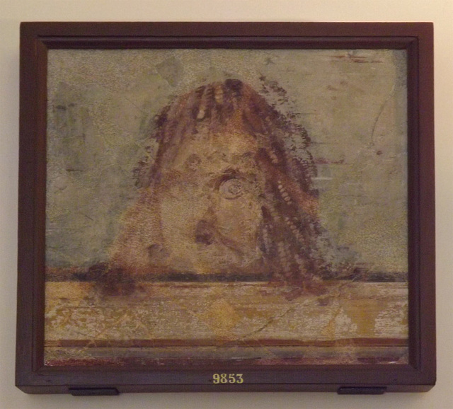 Tragic Mask on Cornice, Wall Painting from Pompeii in the Naples Archaeological Museum, July 2012