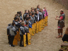 Outdoors lesson about defense tactics of the Roman army.