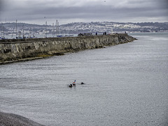 Scuba divers outside the harbour breakwater
