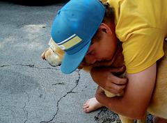 Boy hugs his dog
