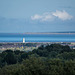 Looking from Thurstaston towards the Mersey Estuary, the tower is Leasowe lighthouse.