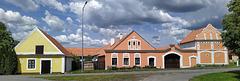 Komárov - popola arkitekturo en stilo de t.n. kamparana baroko en Suda Bohemio