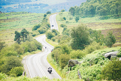 A motorcyclist approaches 'Toads mouth' on the A6187 towards 'Hathersage' - Derbyshire..