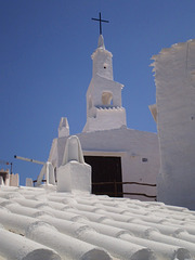 Immaculate white: church, chimneys and roofs.