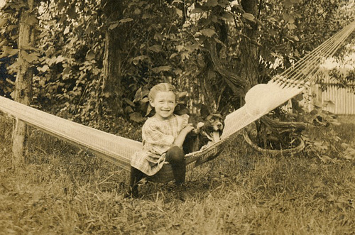A Girl and Her Dog on a Hammock