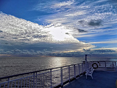 The celestial show: looking beyond the railing to the horizon
