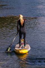 Stand up paddle, woman blonde