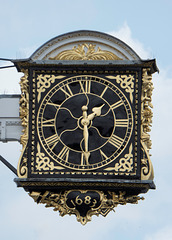 The projecting clock of the historic Guildford Guildhall.