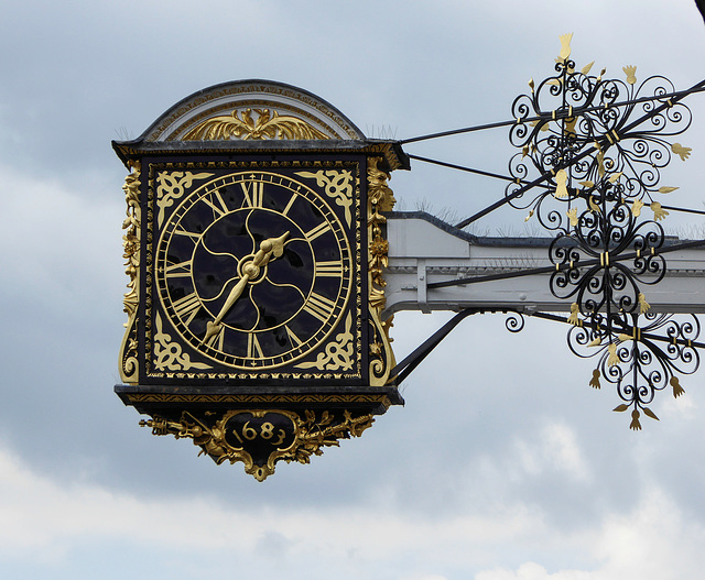 The projecting clock of the Grade 1 listed historic Guildford Guildhall.