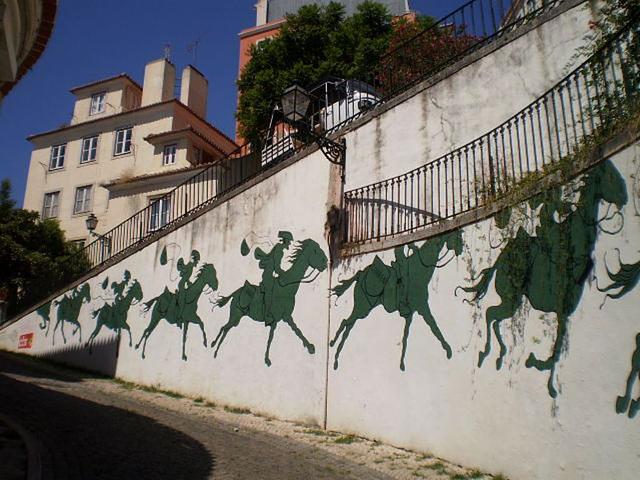Postmen on horseback.