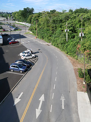 Good view of a parking garage access road from the topmost level of the parking garage it accesses. In Schenectady.