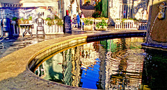 Reflections in the fountain of the square of Dolceacqua