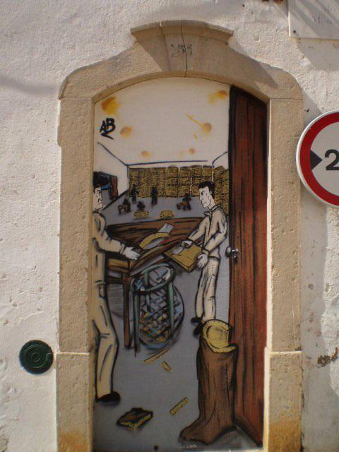 Street art on walled door.