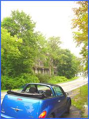 Blue convertible PT Cruiser & haunted house
