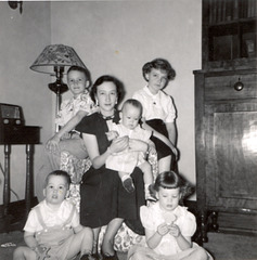 Jean Matlock holding Lisa; John and Mary on floor and Kenneth and Carolyn Couser in back.  April 1951