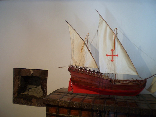 Caravel by the fireplace.