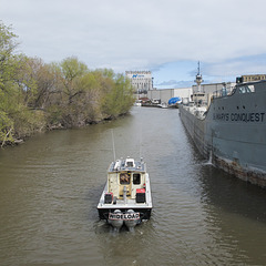 Here was a wideload motoring past the St. Marys Conquest on the Kinnickinnic River, with distant Nidera. What a world.