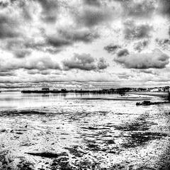 big sky over low tide