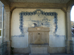 Fountain with tiles panel.