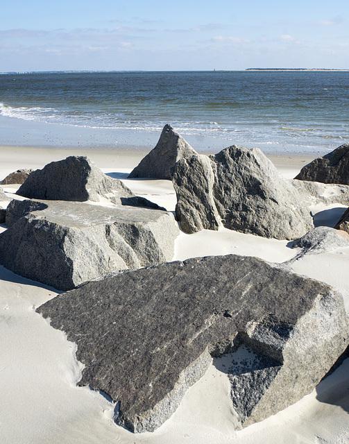 Rocks, unusual on an NC beach