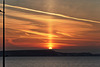 Solar pillar at sunrise
