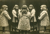 Mirror Photo of a Little Girl Standing on a Chair