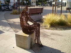 Sculpture of sitting woman.