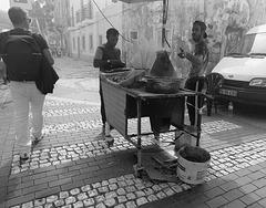 Hot smoky snacks .. at the market... 'Vila Real de Santo Antonio'.... Portugal.