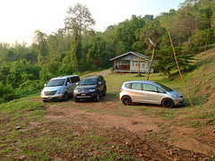 Cars in the morning at the lodges for Huay Mae Khamin waterfall in Kanchanaburi province, Thailand