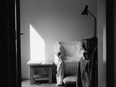 Empty chair near the window