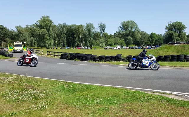 BSA and Triumph on the track