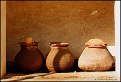 three pots and a cup