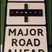 slow - major road ahead sign