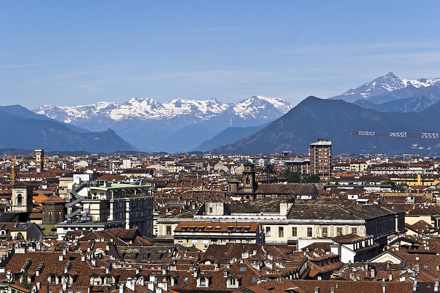 Turin from the top of the bell tower of the St. John Baptist Cathedral - From the rooftops and innumerable skylights of the city to the Susa Valley (To the left on the spur, one can see the Sacra of S