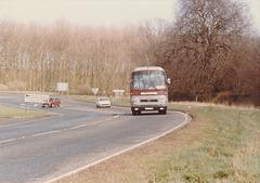 Percivals Coaches 81 (LWL745W) passing Barton Mills - 13 Apr 1985