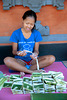 Adii producing canang sari
