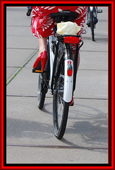 Mature Divinity on her bike in red heels