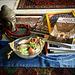 Still life with Buddha head, books and ikebana.
