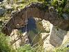 Hole on the board of Ajuda Bridge.