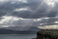 Shafts of light hitting the Welsh hills