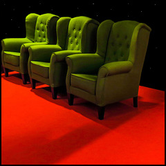 3 chairs on a red carpet