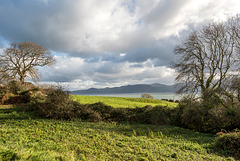 The Menai strait with the hills of Wales in the background