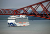 "A train crosses the Forth bridge above the docked ""Royal Princess"""