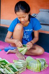 Adii making Canang Sari